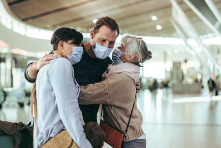 Senior woman receiving her family at airport after flight arriva