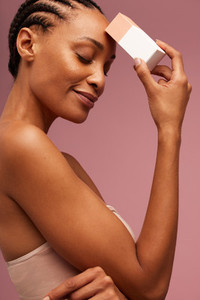 Woman with a beauty product