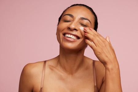Female applying anti aging cream