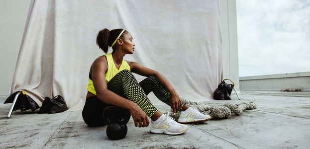 Fitness woman relaxing after workout session
