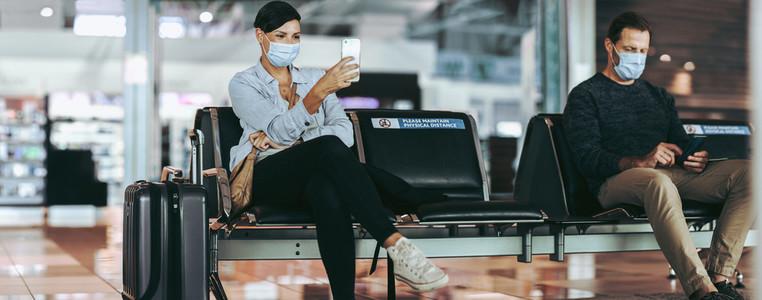 Social distancing at airport waiting lounge