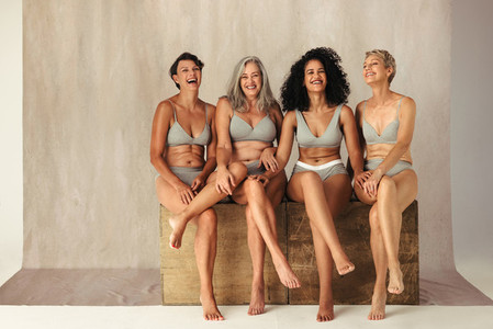 Full body shot of four natural women of different ages