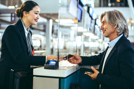 Mature businessman at check in
