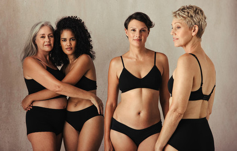 Models of different ages embracing their natural and aging bodie