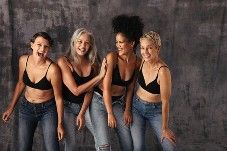 Stylish women of all ages having fun in jeans