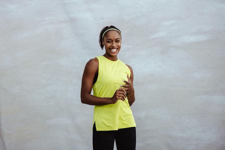 Smiling african woman in sportswear
