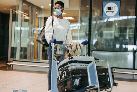 Woman at airport flying during pandemic
