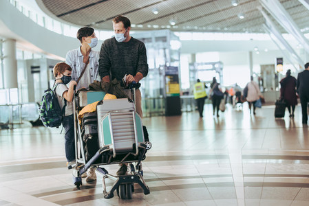 Tourist family at airport with luggage