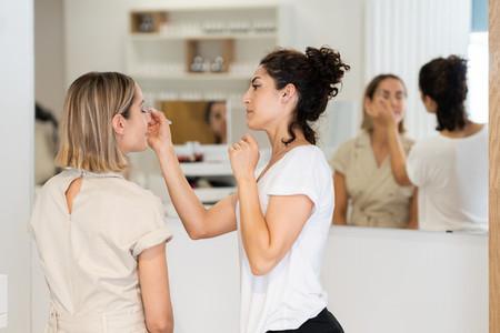 Arab makeup artist making up a woman in a beauty center