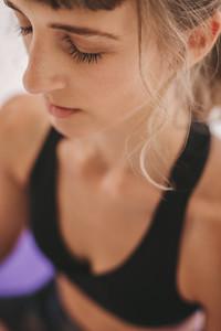 Woman sitting in yoga meditation