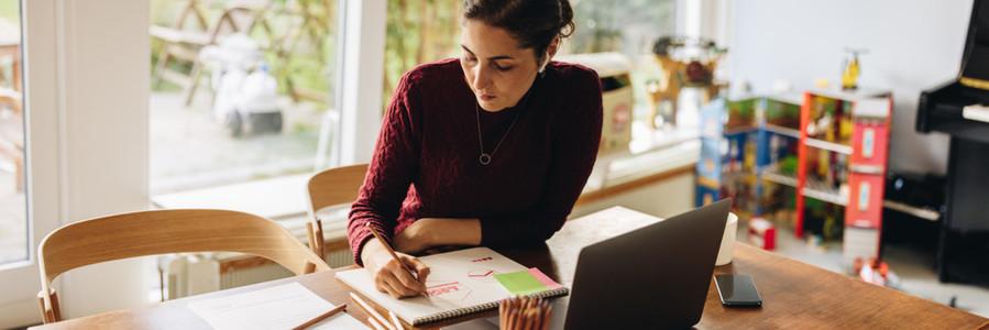 Female artist working on paper