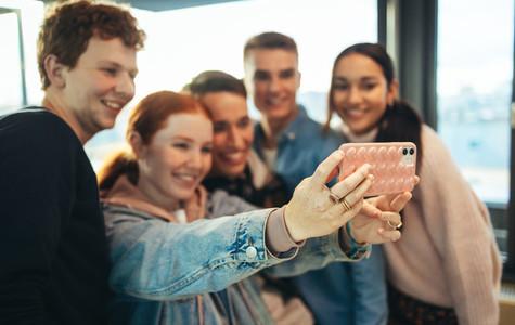 Group of high school students taking selfie