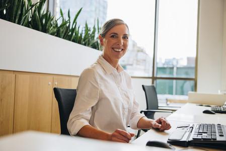 Cheerful businesswoman at work