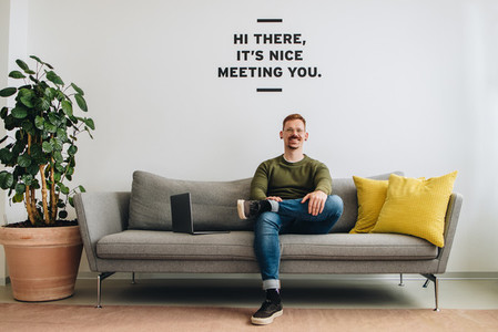 Successful male entrepreneur sitting sofa at lobby