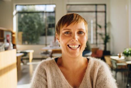 Cheerful female entrepreneur in office