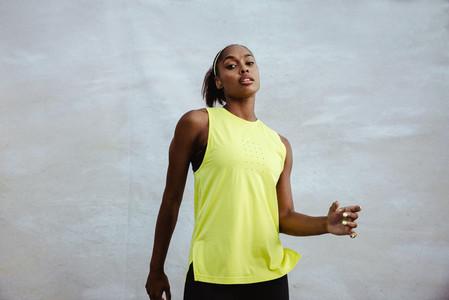 Confident fitness woman in sportswear