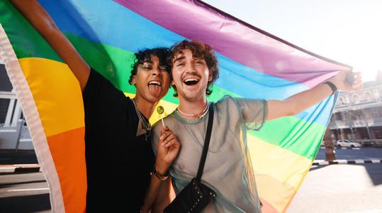 Non conforming men celebrating gay pride outdoors