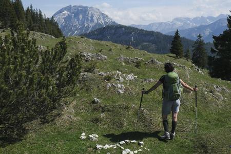 Woman hiking in idyllic sunny mountains Germany