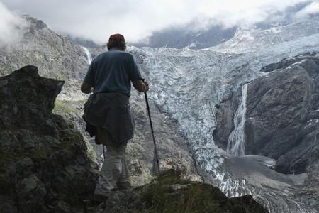 Man hiking in majestic mountain glacier Switzerland