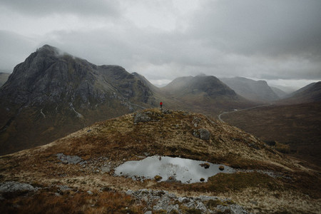 Hiker in rugged remote mountains Scotland