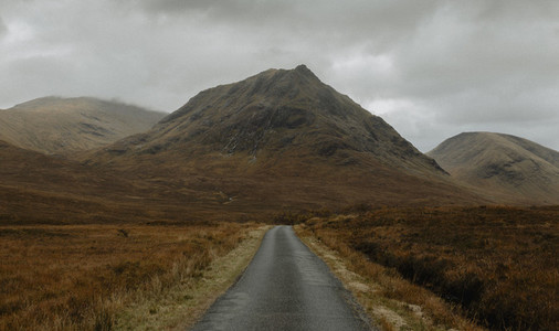 Road leading to rugged remote mountains FScotland