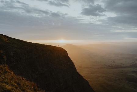 Hiker on mountain peak England
