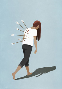 Dejected woman walking with arrows in back
