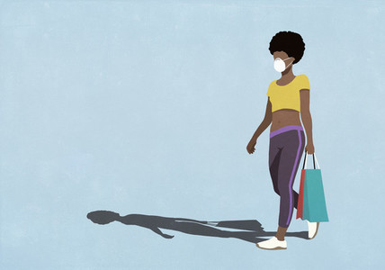 Woman in face mask walking with shopping bags