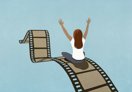 Excited woman riding movie film reel