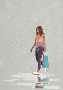 Wet woman with shopping bags walking in rain