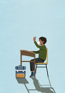 Schoolboy in face mask raising hand at classroom desk