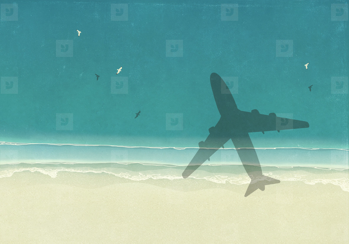 Aerial view shadow of airplane over sunny blue ocean beach