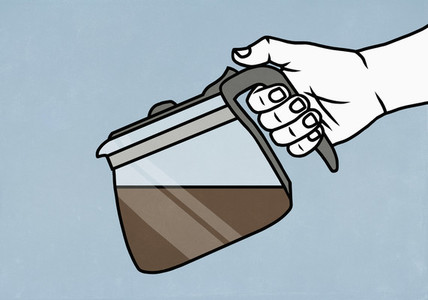 Close up hand holding coffee pot