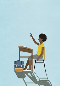 Schoolgirl raising hand at classroom desk