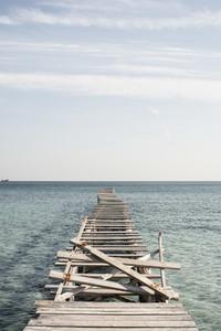 Broken wooden boards on pier Spain