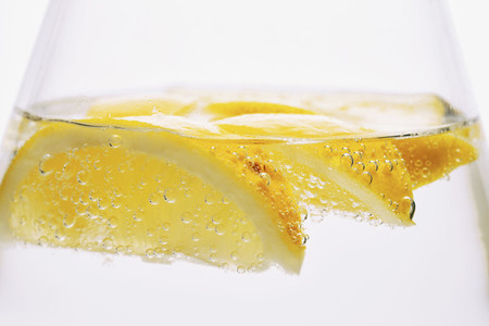 Extreme close up lemon slices in sparkling water