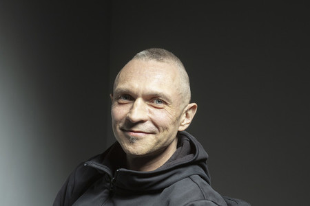 Portrait confident handsome man smiling on black background