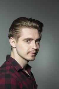 Portrait confident young man in plaid shirt