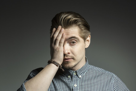 Portrait frustrated man with hand covering face