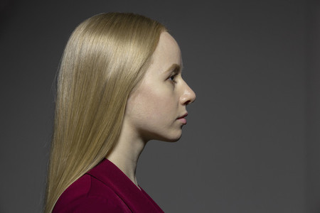 Profile portrait serious young woman with blonde hair
