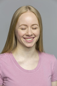 Portrait laughing young woman with eyes closed