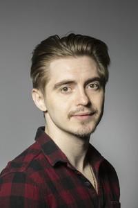 Portrait confident handsome young man