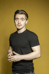 Portrait confident handsome man on yellow background