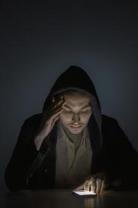 Man using smart phone in dark