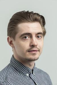 Portrait confident serious young man
