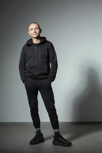 Portrait confident smiling man in black track suit