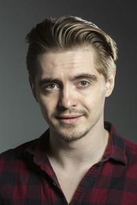 Studio portrait confident blonde man