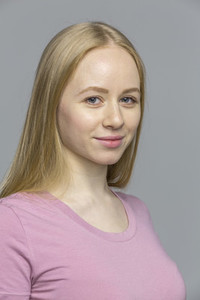 Close up studio portrait confident blonde young woman