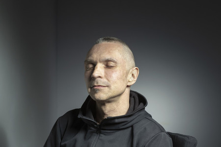 Studio portrait serene man with eyes closed