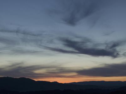 Cloud swirls in blue dusk sky France